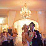 man and woman dancing at their wedding