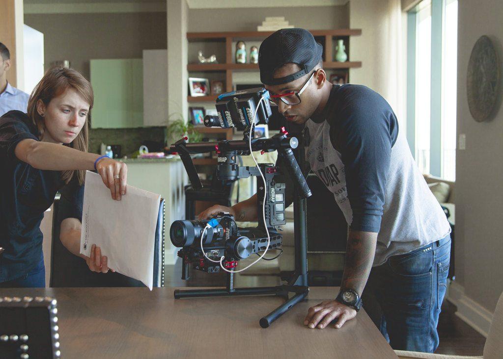 film making photo man behind camera